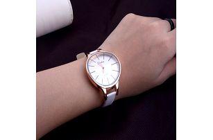 Dámské hodinky s vypouleným ciferníkem