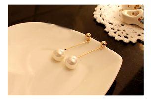 Dámské náušnice polodlouhé s bílou perlou
